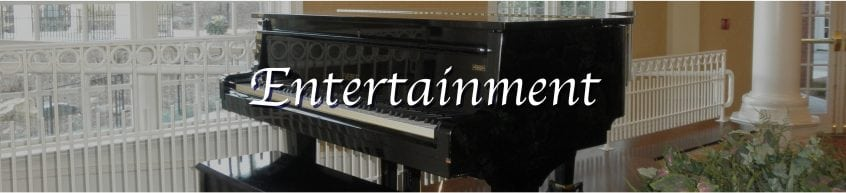 """A black grand piano with lid closed is the backdrop for the title """"Entertainment"""""""